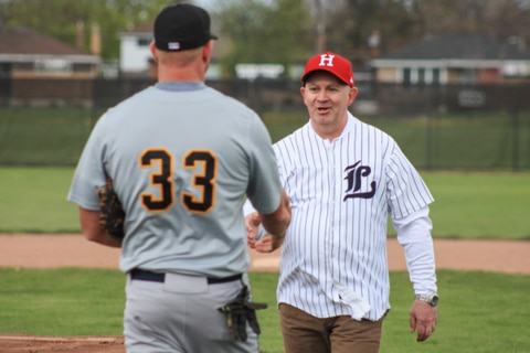 Reed and Reilly shake hands after ceremonial first pitch May 8 in Hamilton. Photo: Glen Cuthbert.