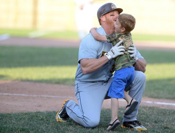Sean Reilly with son, Aiden, after record-setting hit. Photo: Facebook.